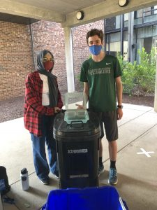 Students and compost bin